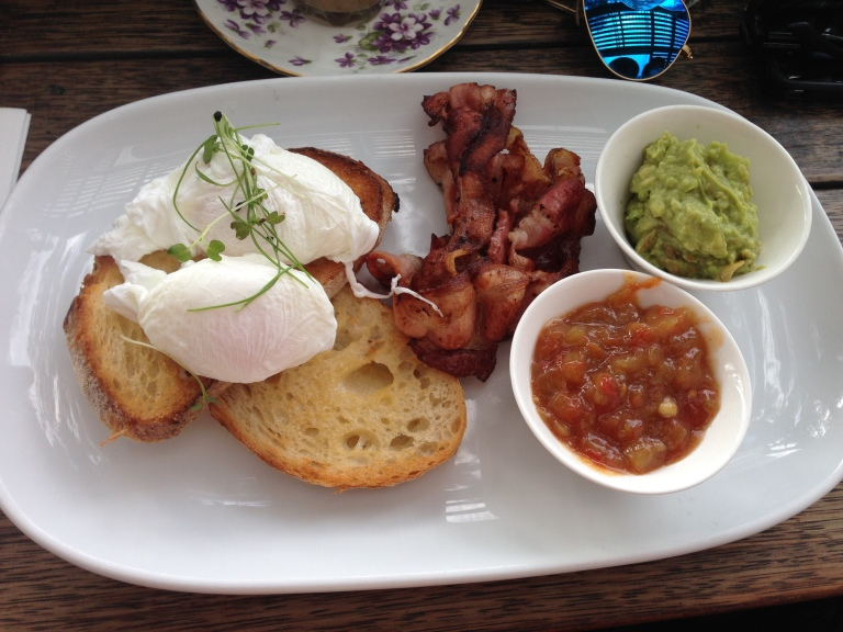 poached eggs, bacon, smashed avo + tomato relish, mart130