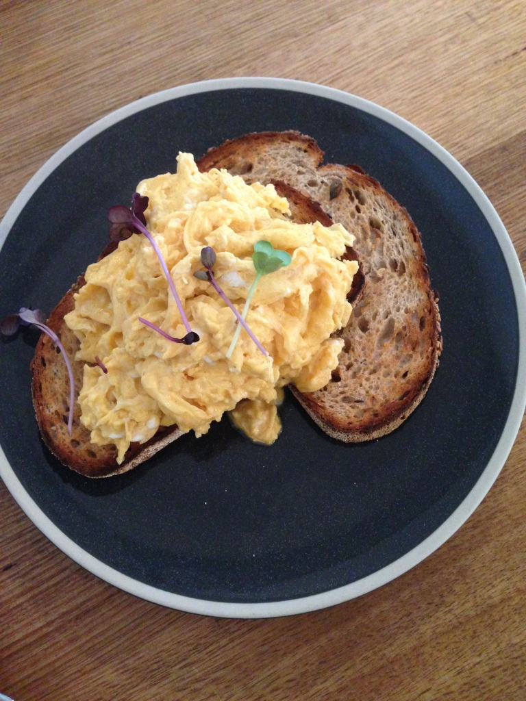 scrambled eggs on grain toast, touchwood